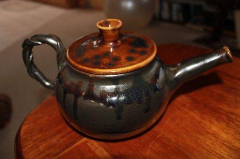 jake - green and brown teapot